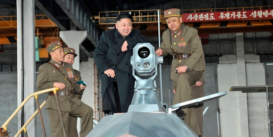 North Korean leader Kim Jong-un looks at the latest combat and technical equipments, made by unit 1501 of the Korean People's Army, during his visit to the unit