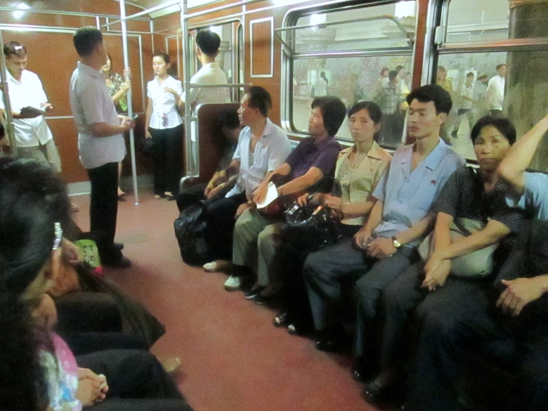 People in Pyongyang subway stanito