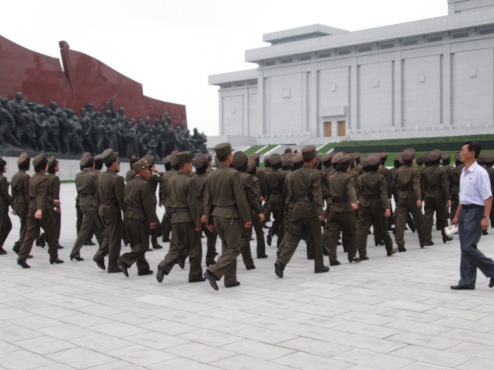 Soldier go to pay homage to the statues of the Leaders